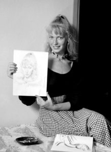 Sylvette-David-with-her-Portrait-by-Picasso_Vallauris_1954